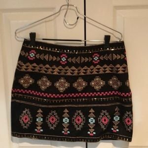 Skirt embroidered with gold thread